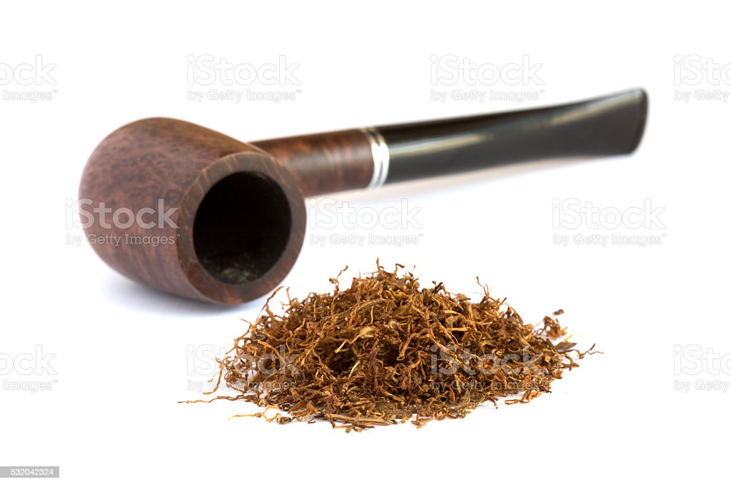 Heap of dry Tobacco and stylish Vintage Pipe stock photo