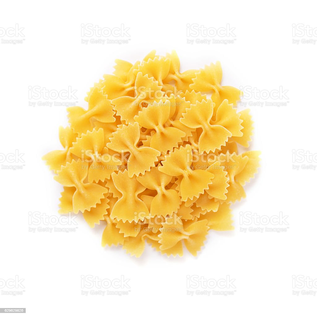 Heap of farfalle pasta isolated on white background. Top view stock photo