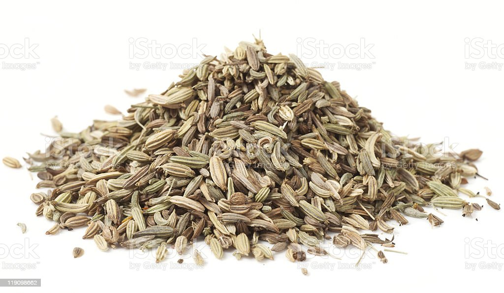 Heap of fennel seeds, macro shot, isolated royalty-free stock photo