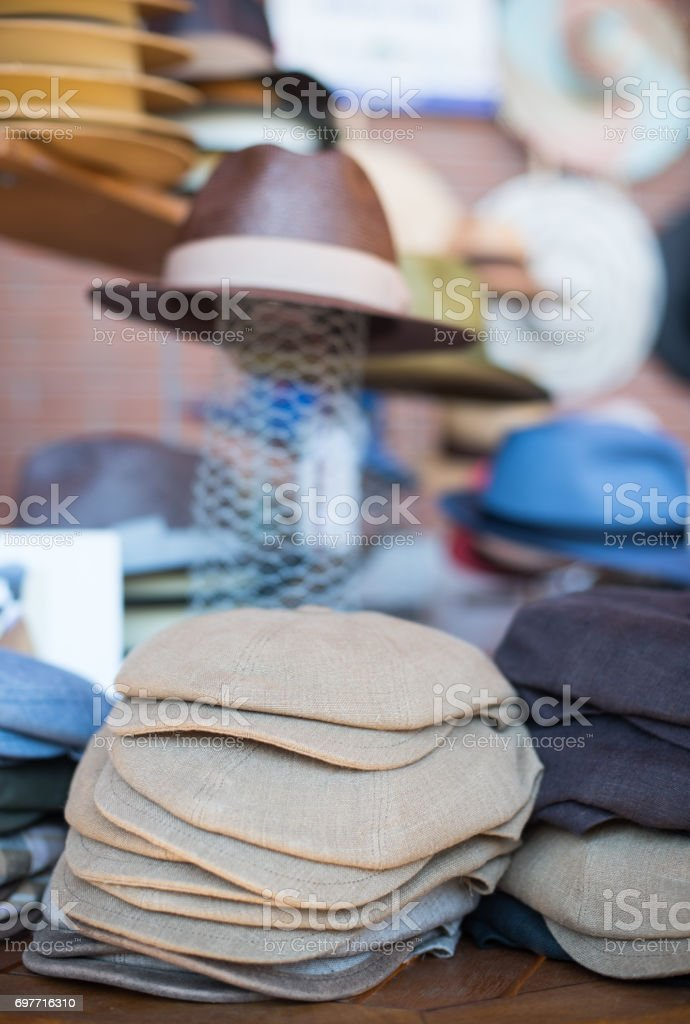 Heap of flat cap hats for sale stock photo