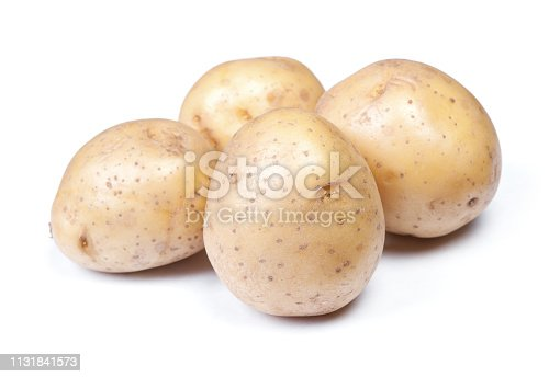 Heap of flawed natural potatoes isolated on white background