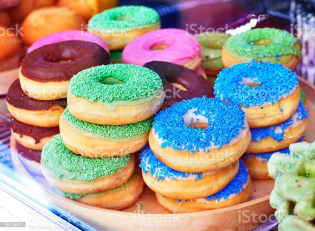 heap of fresh donuts stock photo