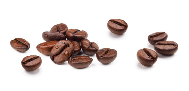 Heap of fresh roasted coffee beans isolated on white background Heap of fresh roasted coffee beans isolated on white background as package design elements roasted coffee bean stock pictures, royalty-free photos & images