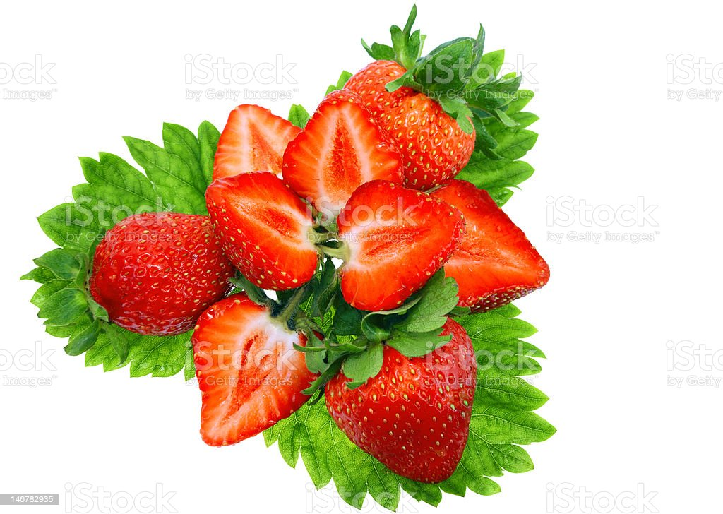 Heap of fresh strawberries on green foliage stock photo