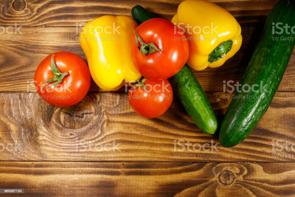 Heap of fresh vegetables on the kitchen table royalty-free stock photo
