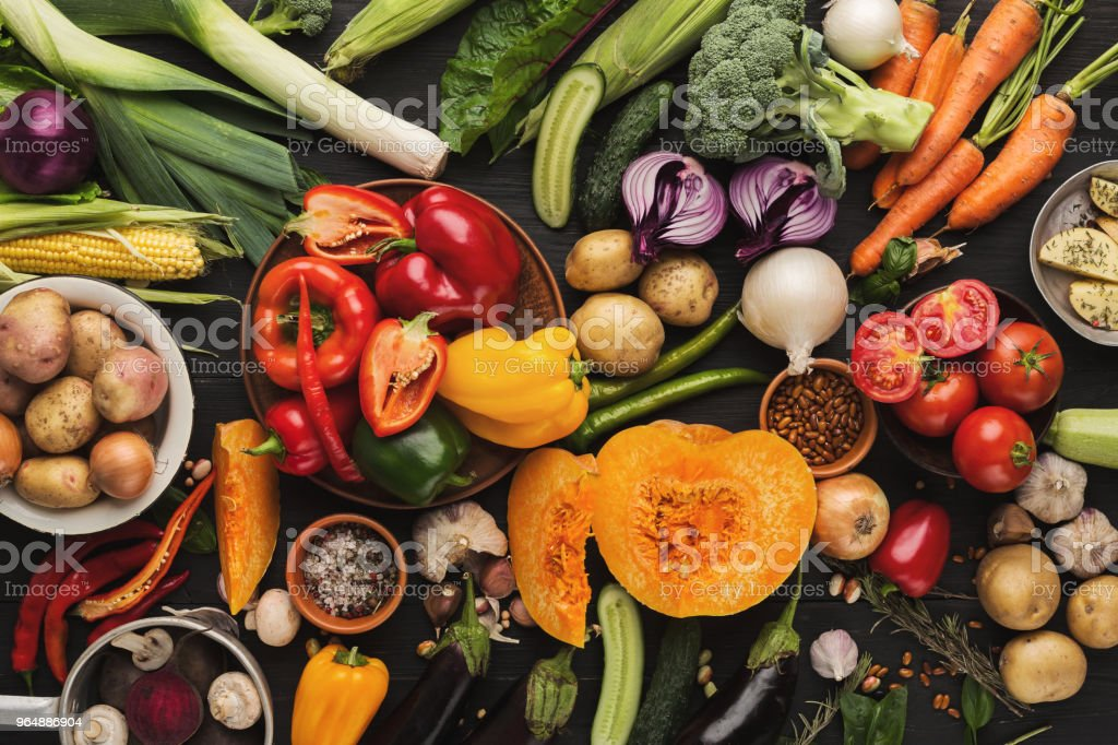 Heap of fresh vegetables on wooden background with copy space royalty-free stock photo