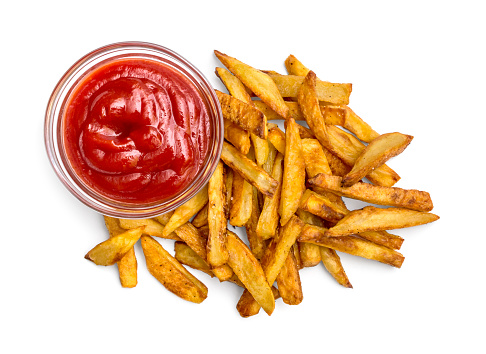 Heap of fried potato with ketchup on white background. Top view.