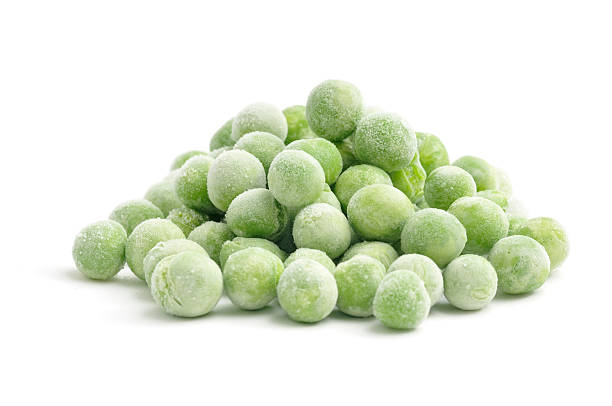 Heap of Frozen Peas stock photo