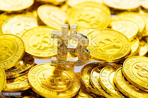 Fujian, China - November 15, 2018: Bunch of memorial golden bitcoins. Bitcoin is a worldwide digital currency that isn't controlled by a central authority such as a government or bank.