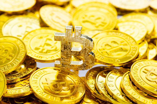 Heap of golden bitcoins background stock photo