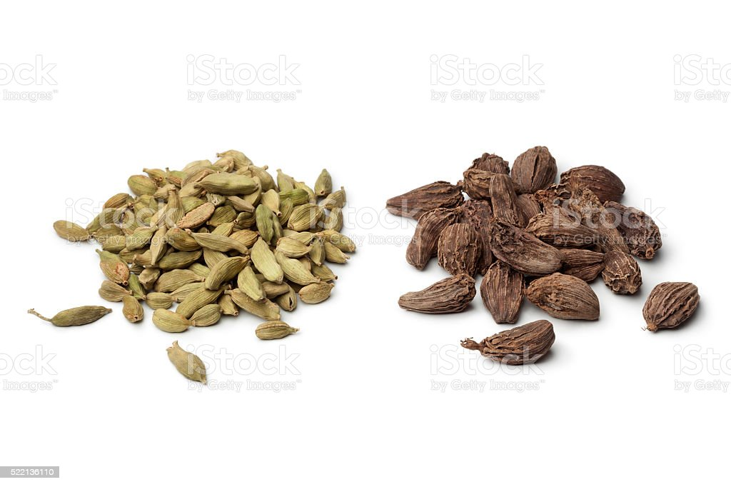 Heap of green and black Cardamom seeds stock photo