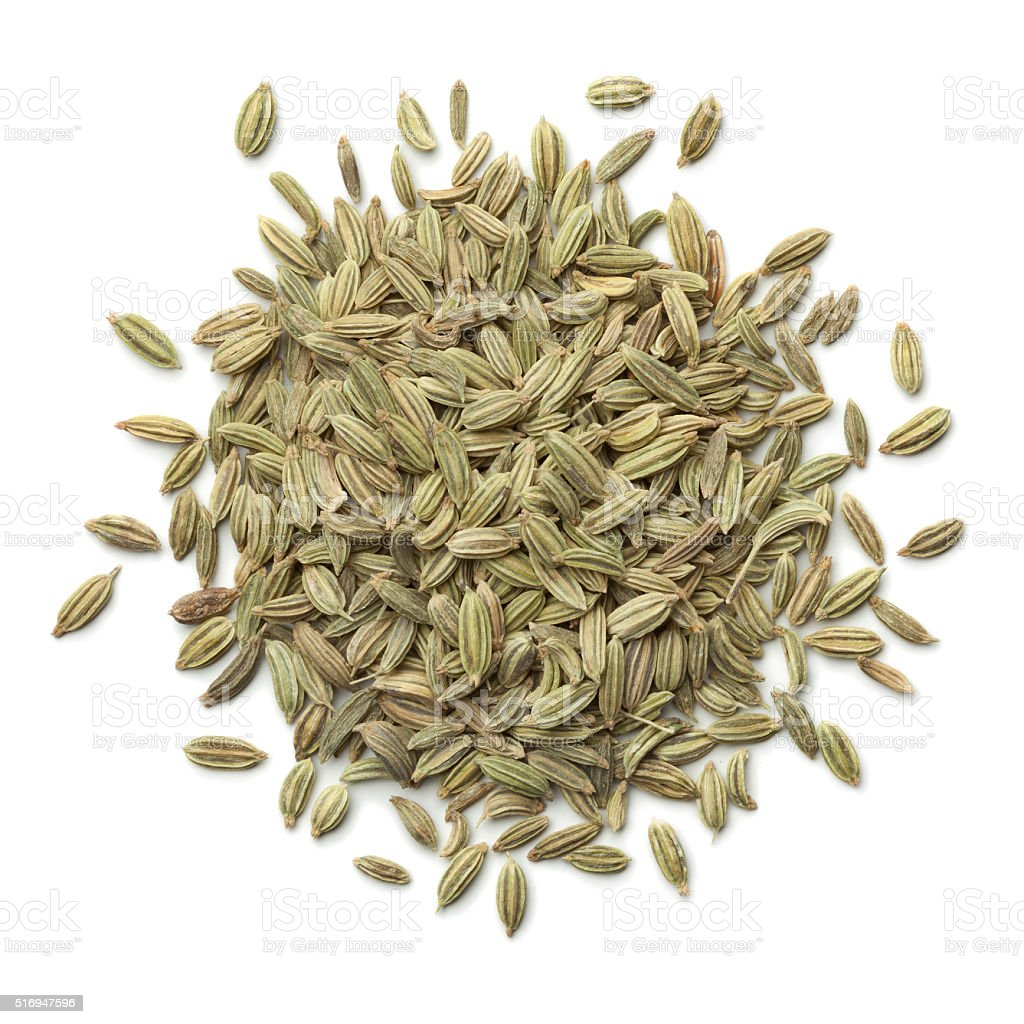 Heap of green fennel seeds stock photo