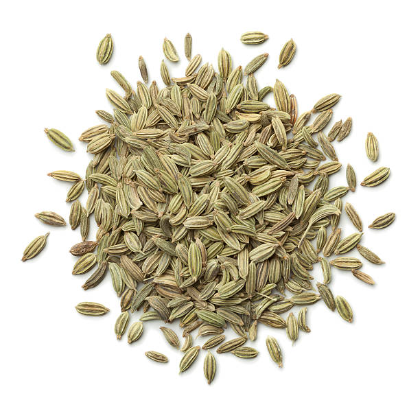 Heap of green fennel seeds Heap of green fennel seeds on white background fennel stock pictures, royalty-free photos & images
