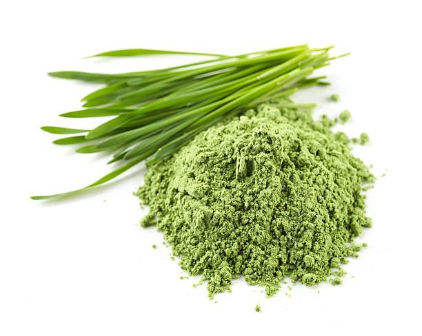 heap of green powder stock photo