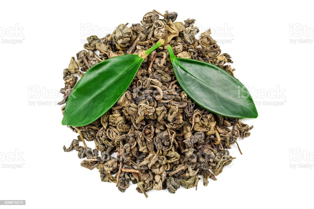 heap of green tea with leaves on white stock photo