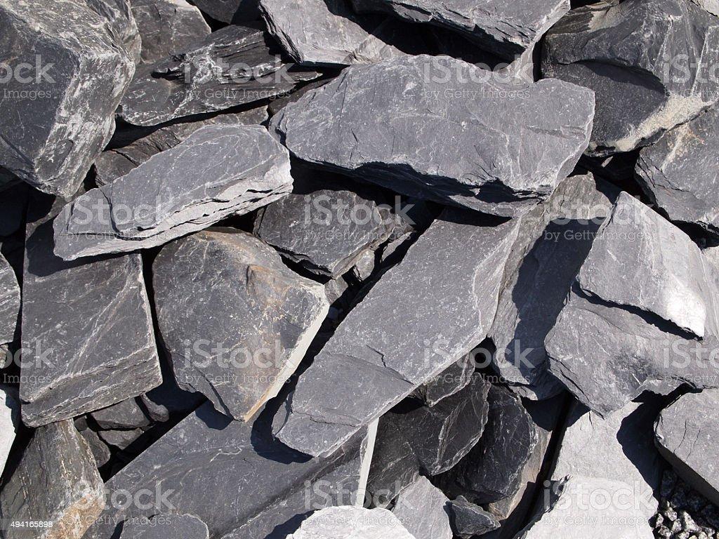 Heap of grey slate stones.