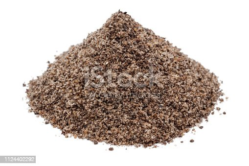 Heap of ground black peppercorn isolated on white background