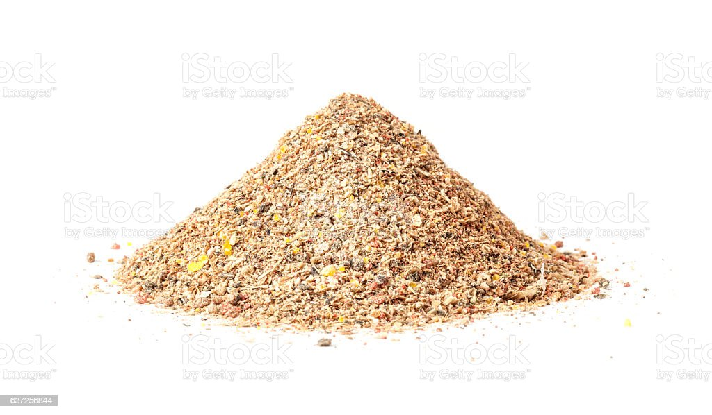 Heap of groundbait isolated on white background stock photo