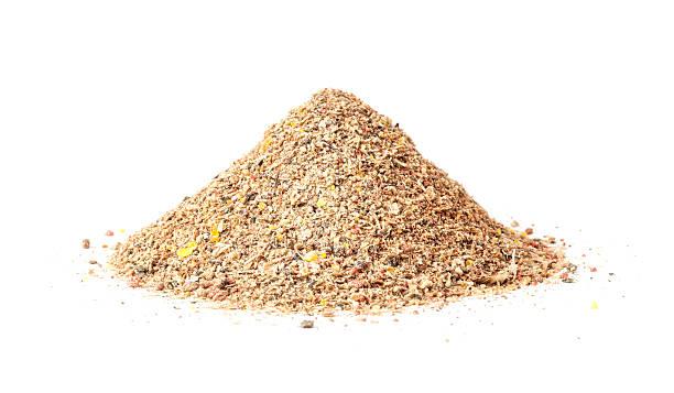Heap of groundbait isolated on white background stock photo