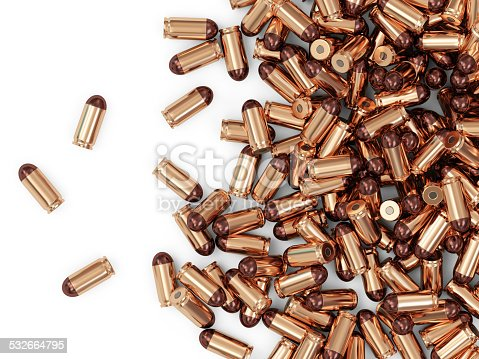 1043434568 istock photo Heap of Gun Bullets isolated on white background 532664795
