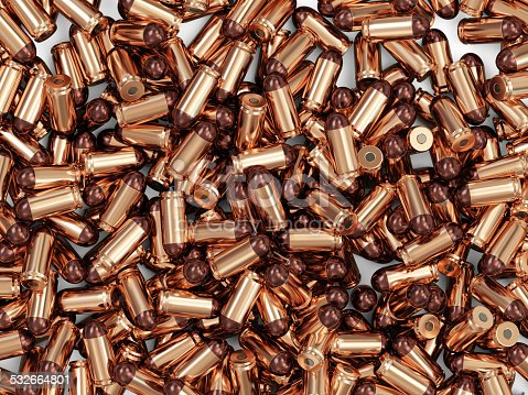 1043434568 istock photo Heap of Gun Bullets isolated on white background 532664801