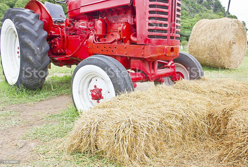 Heap of hays with farmer's vehicle. stock photo