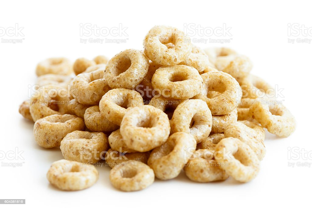 Heap of honey cheerios isolated on white. stock photo