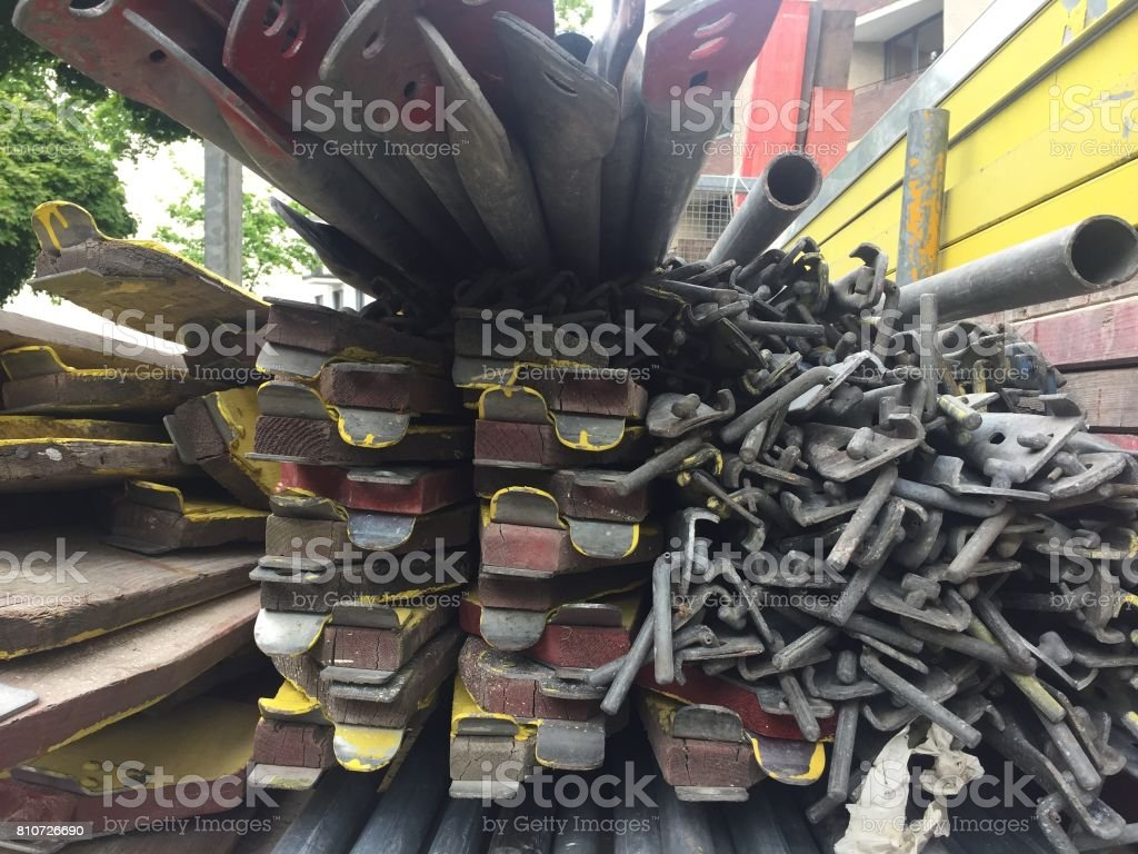 Heap of iron and wooden beams on construction site stock photo