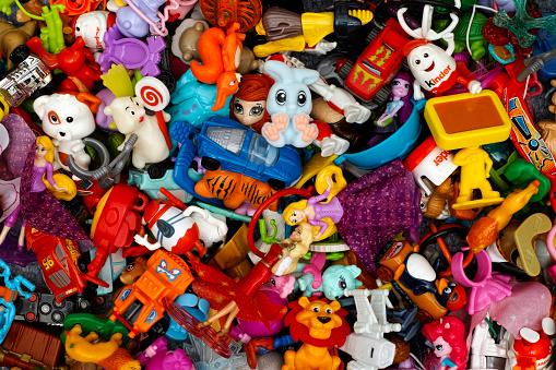 Tambov, Russian Federation - March 25, 2016: Big heap of Kinder Surprise toys. Studio Shot.