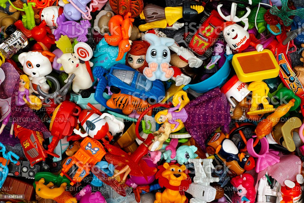 Heap of Kinder Surprise toys stock photo