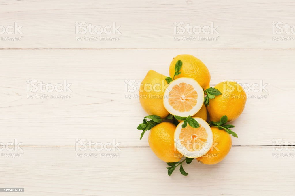 Heap of lemons on rustic wooden background, top view royalty-free stock photo