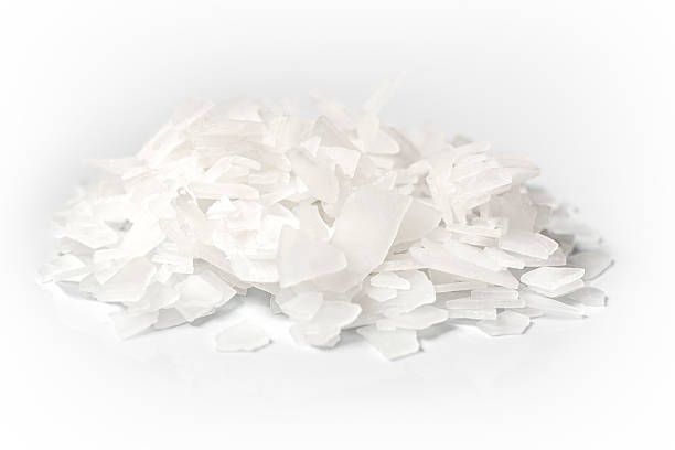 heap of magnesium flakes on white background - magnesium stock photos and pictures