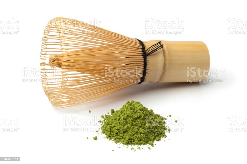 Heap of matcha tea and a whisk stock photo