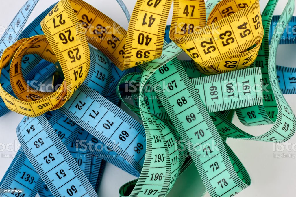 Heap of measuring tapes. stock photo