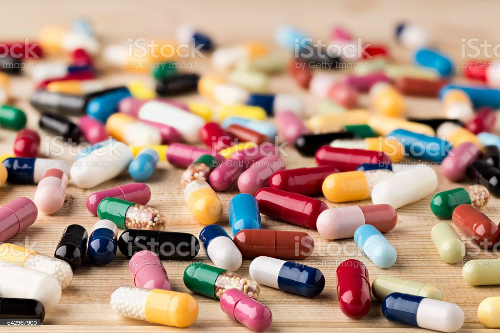 Heap of medicine capsules and pills stock photo