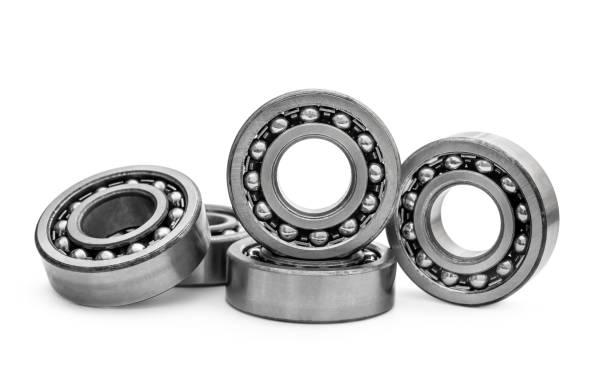 Heap of metal bearings on white. Heap of metal bearings on white. ball bearing stock pictures, royalty-free photos & images