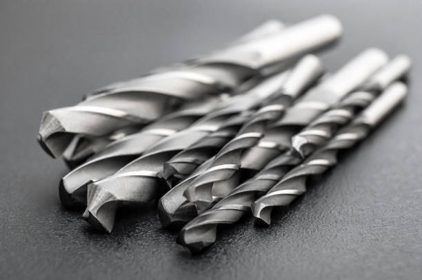 Heap of metal drill bits on black background. Heap of metal drill bits on black background. drill bit stock pictures, royalty-free photos & images
