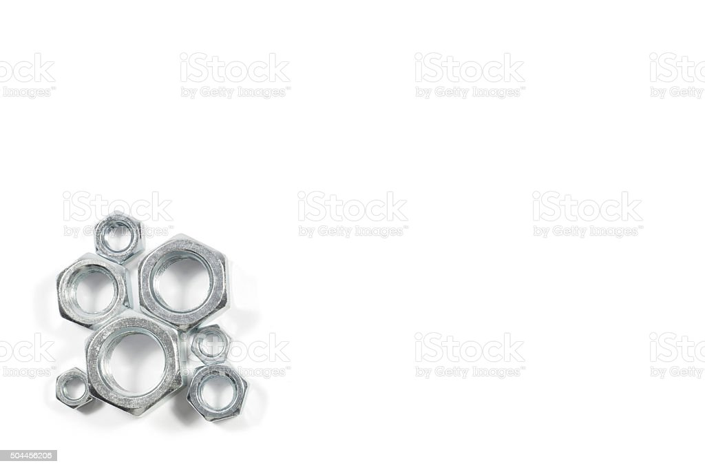 Heap Of Metal Nuts Of Various Sizes Isolated On White stock photo