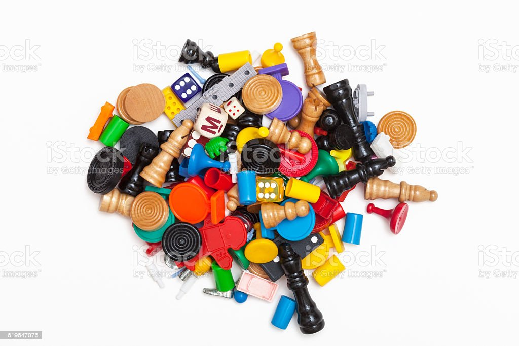 Heap of miscellaneous game pieces stock photo