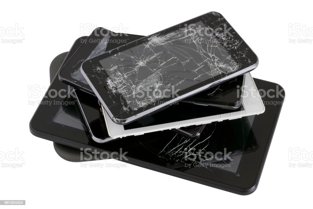 Heap of modern electronic gadgets with the broken screens. Devices are prepared for utilization. Isolated with patch stock photo
