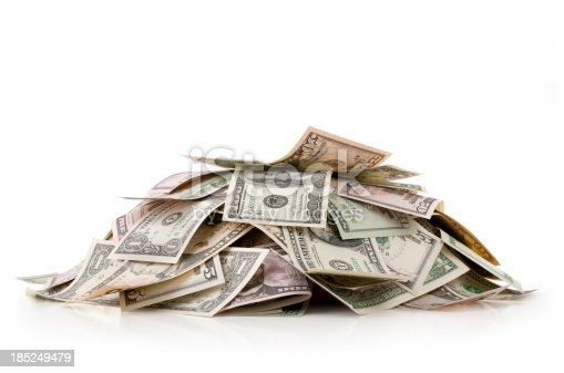 Heap of money. Dollar bills. Photo with clipping path.
