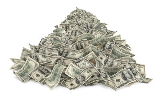 Heap of money (one hundred-dollar bills) isolated on white background.