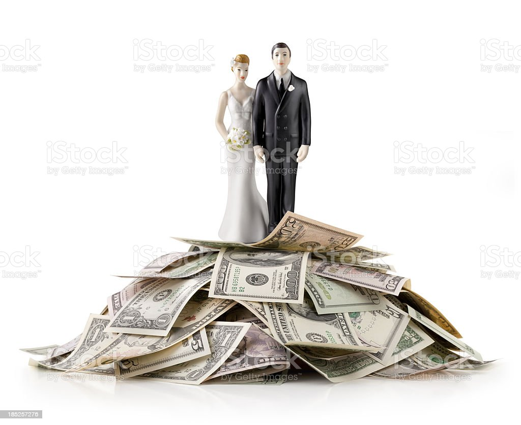 Heap of money with wedding cake topper stock photo