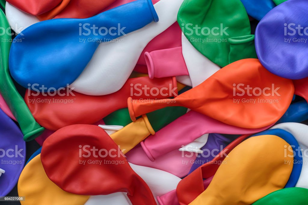 Heap of non inflated balloons stock photo
