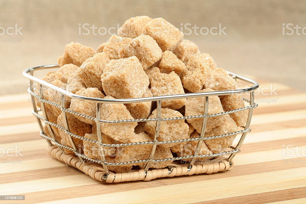 Heap of not refined brown reed sugar in a basket royalty-free stock photo
