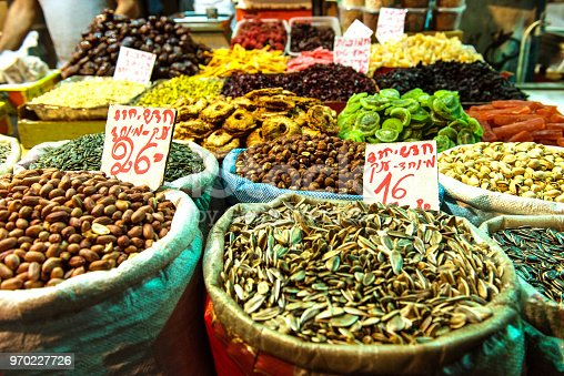 istock Heap of nuts and sunflower seeds, pistachio in bags 970227726