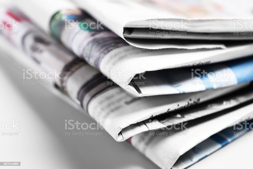 Heap of old newspapers, selective focus stock photo