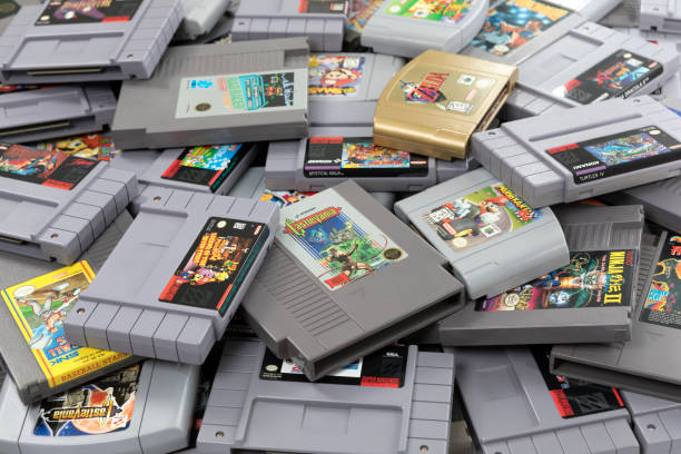 A Heap of Old Video Game Cartridges Taipei, Taiwan - February 20, 2018: A studio shot of a large heap of old video game cartridges. nintendo stock pictures, royalty-free photos & images