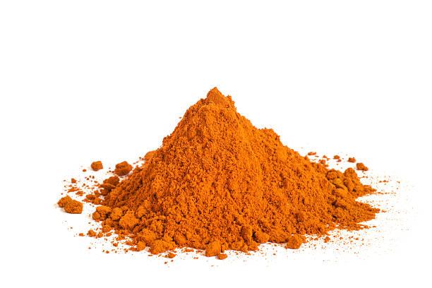 heap of paprika or chii powder on white background - paprikapoeder stockfoto's en -beelden