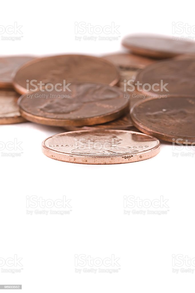 heap of pennies on white background royalty-free stock photo